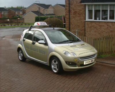 A nice view of our automatic car, the smart forfour in pale green, striking with is silver livery